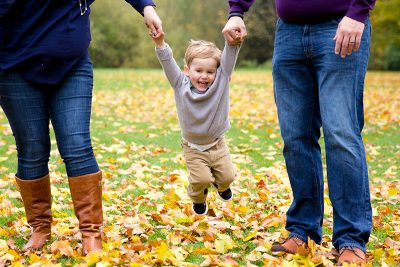 Smiling Child Being Swung By Parents Family Photo NV Holden Photography